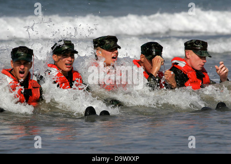 Navy SEAL candidates during surf passage exercises on the first phase of training at Naval Amphibious Base Coronado - Stock Photo