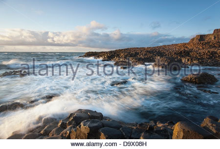 Sunset Over The Giant's Causeway A Unesco World Heritage Site; Country Antrim Northern Ireland - Stock Photo