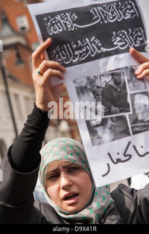 London, UK. 27th June 2013. A woman with her placard as Egyptians in London protest against sectarian killings in - Stock Photo