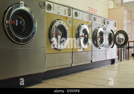 Stainless steel washing machines, coin operated - Stock Photo