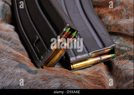 2 magazines loaded with .223 caliber or 5.56mm ammunition - Stock Photo
