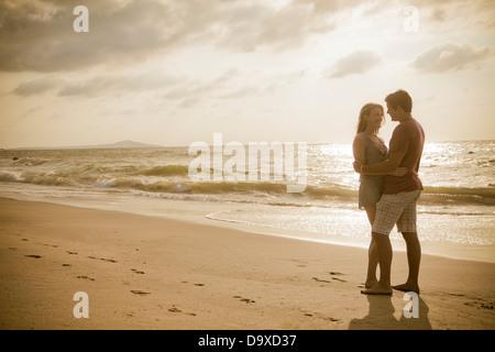 Romantic young couple on beach - Stock Photo