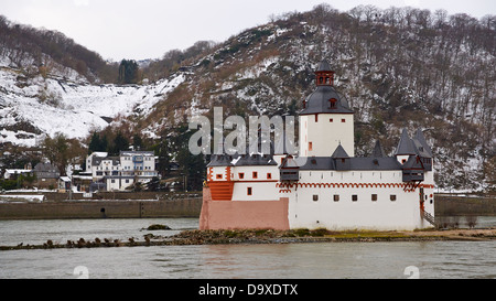 Pfalzgrafenstein Castle in the middle of the Rhine river in winter - Stock Photo