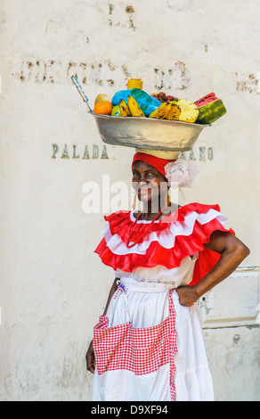 Palenquera woman sells fruits at Plaza Santo Domingo on December, 02, 2009 in Cartagena, Colombia - Stock Photo