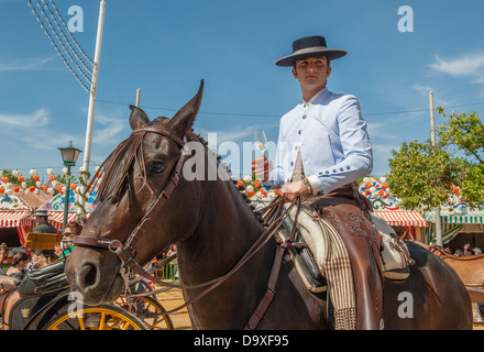 Horse rider with a glass of manzanilla at the Seville's April Fair on April, 25, 2012 in Seville, Spain - Stock Photo