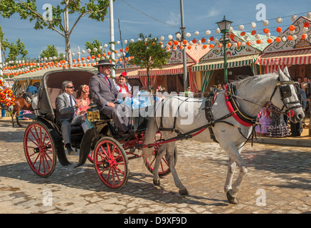 SEVILLE, SPAIN - April, 25: Parade of carriages at the Seville's April Fair on April, 25, 2012 in Seville, Spain - Stock Photo