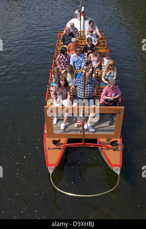 Tourists ride the Historic Swan Boats in Boston Public Gardens on a summer day, Boston, Ma - Stock Photo