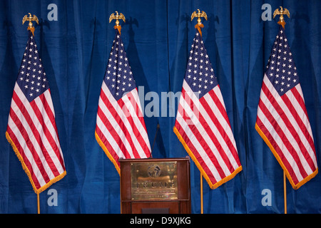 Podium US Flags Trump International Hotel in Las Vegas where Donald Trump would endorse Presidential Candidate Mitt - Stock Photo
