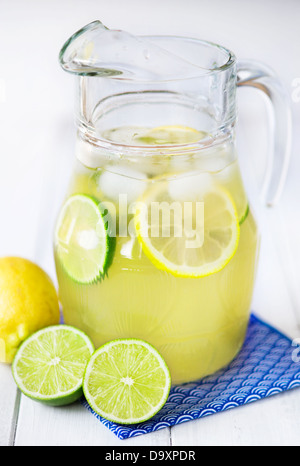 Pitcher full of lemon and lime lemonade with ice - Stock Photo