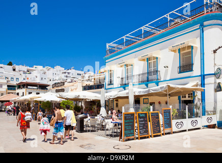 Seafood Restaurant and Tourists Largo Cais Herculano Albufeira Old Town Algarve Portugal EU Europe - Stock Photo