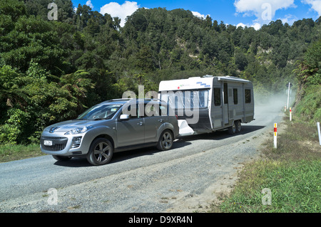 dh Forgotten World Highway OHURA ROAD NEW ZEALAND 4x4 off roader car pulling caravan on SH43 state highway road