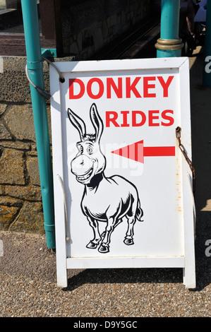Sign 'Donkey Rides' on beach of Weston Super Mare UK - Stock Photo