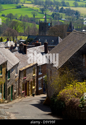 View over rooftops to Wirksworth a small rural market town near Matlock in the Derbyshire Dales Peak District England - Stock Photo