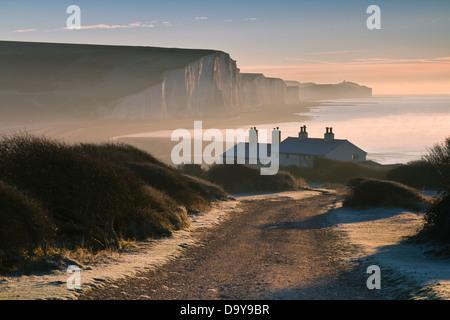 Sussex coast guard cottages sunrise, - Stock Photo