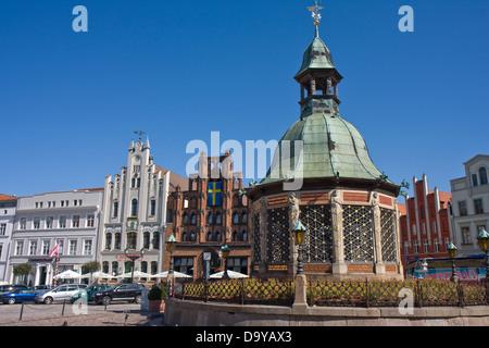 Europe, Germany, Mecklenburg-Western Pomerania, Wismar,Wasserkunst at the marketsquare - Stock Photo