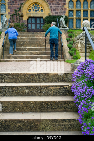 Tourists at Knightshayes Court country house in Devon, England, UK - Stock Photo