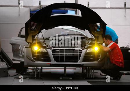 Watkins Glen, New York, USA. 28th June 2013. The Audi Sport Customer Racing Audi R8 (24) driven by Edoardo Mortara - Stock Photo