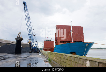 Container ships unloading coal by crane at Glasson Dock, Lancashire, England - Stock Photo