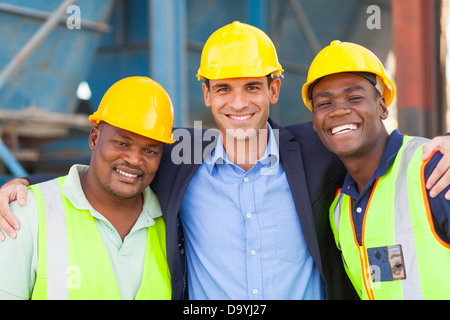happy heavy industry manager and workers portrait - Stock Photo