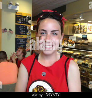 Chicago, Illinois, USA. 28th June, 2013. Blackhawks fan stops for lunch at Einstein Bagel after the Chicago Blackhawks - Stock Photo