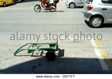 An unofficial reserved vehicle parking space in an Athens street, in Greece. - Stock Photo