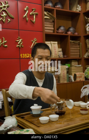 Tea being prepared in a Beijing tea shop by the tea shop owner, China. - Stock Photo