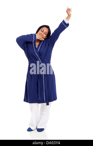 young sleepy indian woman yawning and stretching before bedtime isolated on white - Stock Photo