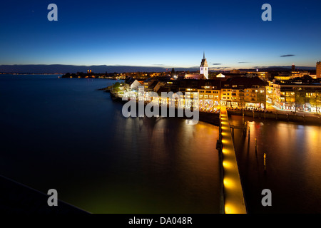 City and waterfront of Friedrichshafen, Germany at night seen from an observation tower in the harbor. - Stock Photo