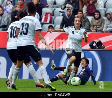 Germany's Anja Mittag (top) vies for the ball with Japan's Saori Ariyoshi (bottom) during the Women's international - Stock Photo