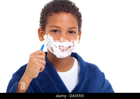 playful little african young boy shaving face over white background - Stock Photo