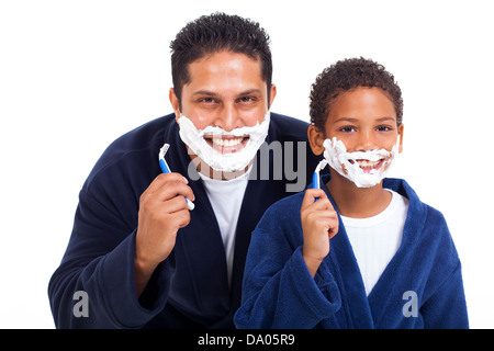 playful little indian boy shaving with father isolated on white - Stock Photo