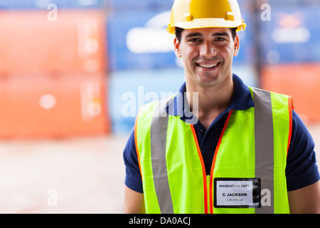 close up portrait of smiling harbor warehouse worker - Stock Photo