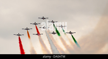 italian aerobatics team in formation deploying smoke - Stock Photo