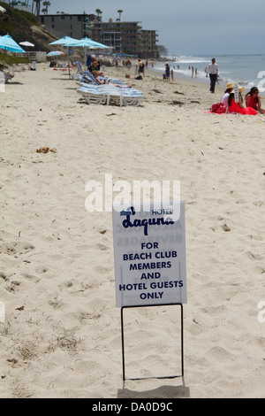 A sign on the beach at the Hotel Laguna guests only and beach club members only area. Laguna Beach California - Stock Photo