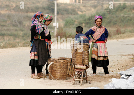 Colorfully dressed Flower Hmong women fixing the road, Sapa, Vietnam, Southeast Asia - Stock Photo