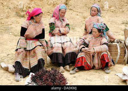 Colorfully dressed Flower Hmong women at the market in Bac Ha, Vietnam, Southeast Asia - Stock Photo