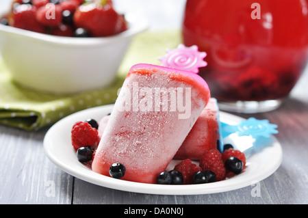 homemade strawberry ice cream with fresh berries - Stock Photo