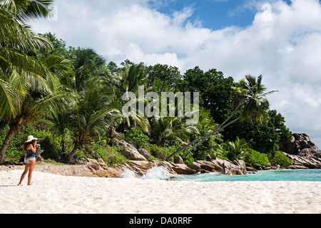 Granite boulders on the shore at Anse Severe ,La Digue,Seychelles, Indian Ocean, Africa - Stock Photo