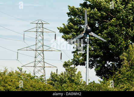 Domestic small scale wind turbine to generate electricity for a small farm or business - Stock Photo