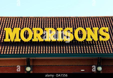 Morrisons supermarket sign, logo, Fakenham, Norfolk England UK supermarkets logos - Stock Photo