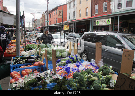 Philadelphia 9th Street Italian Market view of a vegetables seller stand. - Stock Photo