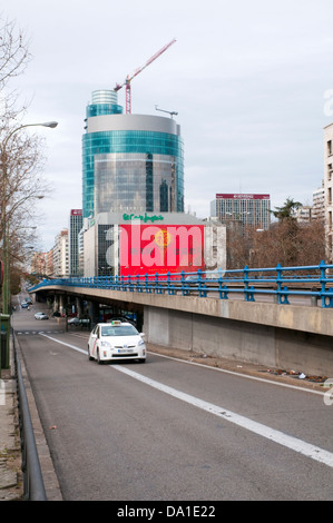 Titania Tower and taxi viewed from Joaquin Costa street. Madrid, Spain. - Stock Photo