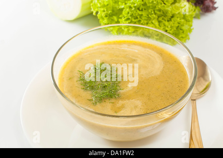soup pureed vegetables in glass dish closeup - Stock Photo