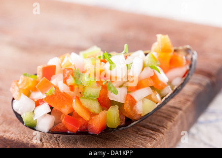 Steamed mussel with vegetable mince on a wooden table - Stock Photo