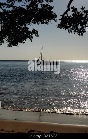 A boat lies before the island Inhaca Island in Mozambique, 24 February 2013. Photo: BRITTA PEDERSEN - Stock Photo