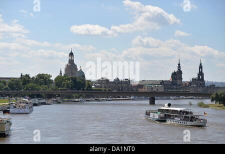 A pleasure boat steams towards the Dresden Frauenkirche (L-R) and the cathedral on the Elbe in Dresden, Germany, - Stock Photo