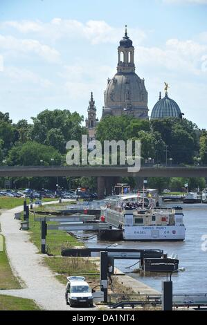 Ships are moored at the Elbe in Dresden, Germany, 01 July 2013. The Dresden Frauenkirche can be seen in the background. - Stock Photo