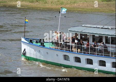 A pleasure boat steams on the Elbe in Dresden, Germany, 01 July 2013. The flood has completly receided from the - Stock Photo