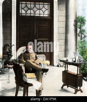 Cecil John Rhodes, British colonial administrator, on his verandah near Cape Town, South Africa, c. 1900. Hand-colored - Stock Photo