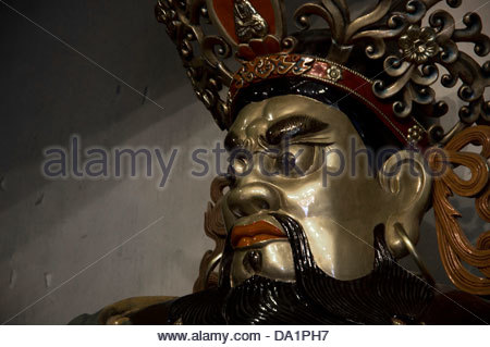 God statue in entrance to temple courtyard statues in the Po Lin Monastery - Stock Photo